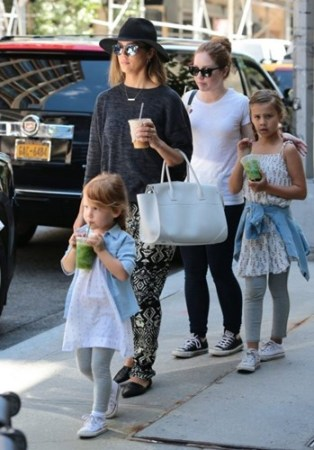 Jessica Ditzel with her daughters, and their nanny (white tshirt)