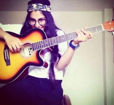 Chetna Sharma playing guitar