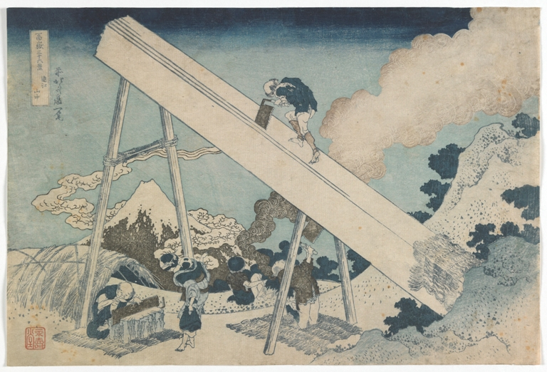 "The sacred mountain appears in the distance, framed by the ""A"" support securing a large timber as two carpenters saw planks and another sharpens his saw under a straw lean-to."