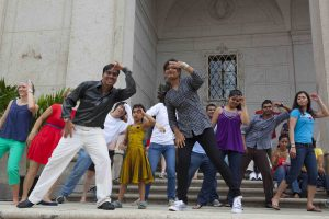 Group of dancers leading Bollywood class in front of Freer steps.