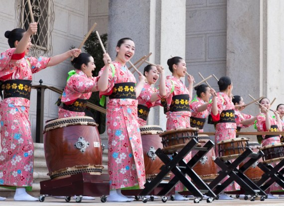 Women drummers in traditional kimono peforming on the steps of the Freer Gallery.