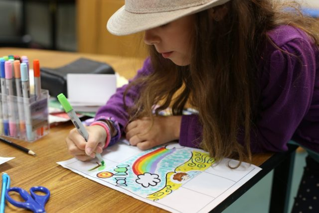 A student carefully works on her anime project during the ImaginAsia workshop.