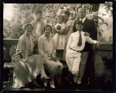 Eugene Meyer and family of six stand for traditional family portrait.