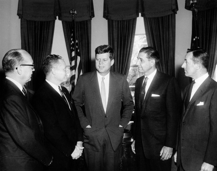 US Ambassador Leon Poullada stands to the left of President John F. Kennedy. Image c/o Abbie Rowe. White House Photographs. John F. Kennedy Presidential Library and Museum, Boston