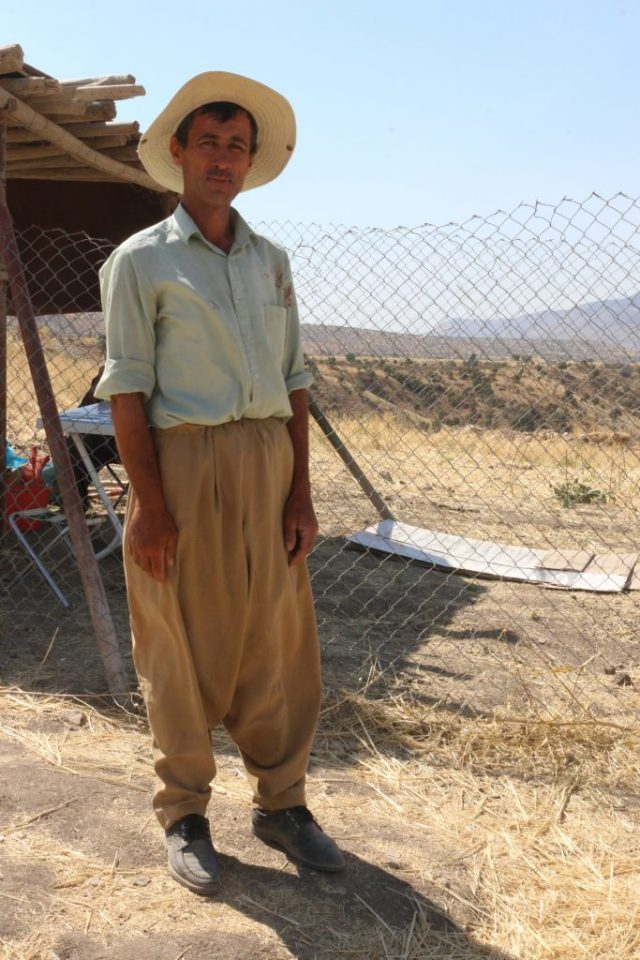 Man standing near excavation site.