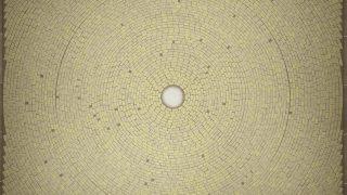 Beige tiles arranged in a radial fashion around a soft white center.