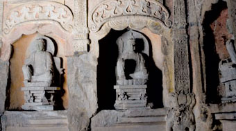 Grottos containing Buddhist sculpture