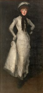 Woman in modest white dress and white hat