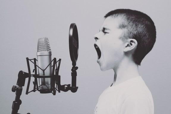 boy shouting to mic
