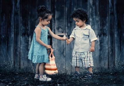 girl giving flower to boy