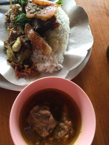 Rich, spicy pork soup accompanying Warung Ibu Suna's Babi Guling in Kedawtan near Ubud