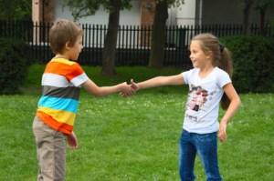 Kids Shake Hands © Andromantic | Dreamstime.com