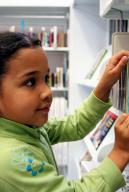 young-girl-in-library-c-rmarmion-dreamstime_com.jpg