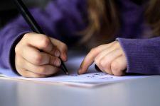 A-kid-drawing-or-writing wikimedia commons upload by dotmatchbox by flickr