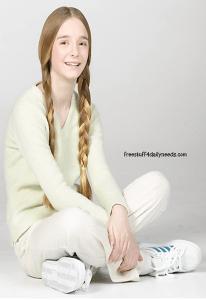 girl sitting cross legged