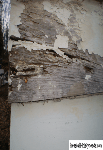 rotting wood garage wall