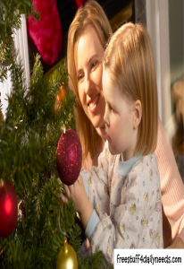 mom and child decorating christmas tree