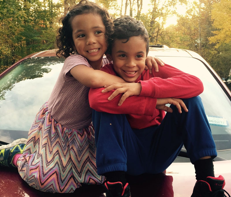 Ellie, left, who is transgender, hugs her brother Ronnie. (Courtesy Ford family)