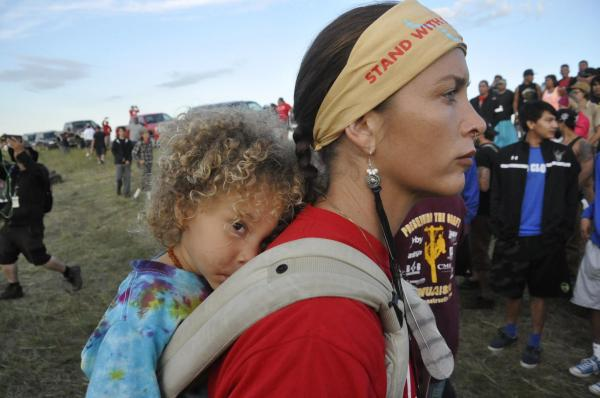 Mother and child at the frontlines on the Standing Rock Reservation in North Dakota on August 16, 2016. Courtesy John Heminger.