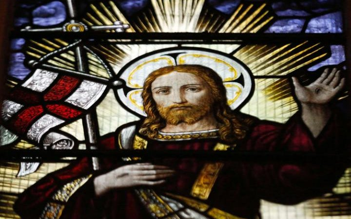 A stained glass window at Rochester Cathedral depicts the resurrection of Jesus Credit: Luke MacGregor/Reuters.