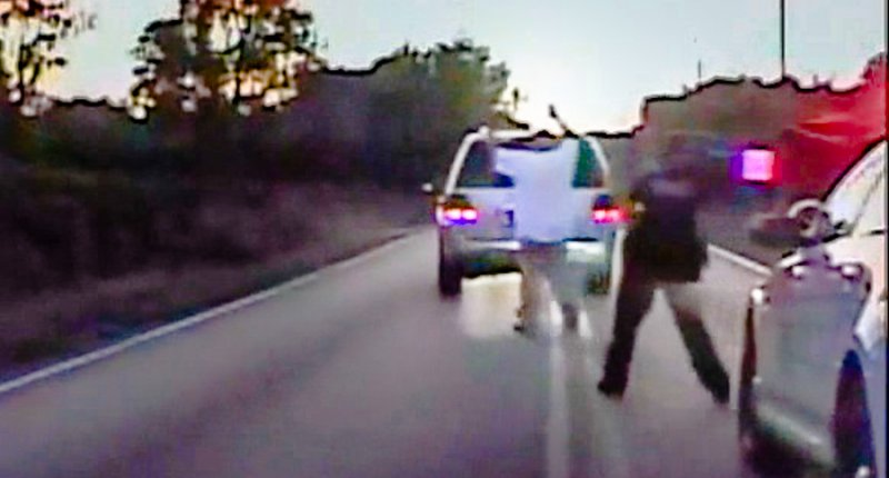 Dash cam video shows Terence Crutcher with hands above his head (screen grab)