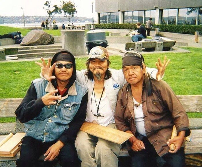 John T. Williams, center, with brother Eric to his right and brother Rick to his left, pose for a photo at Victor Steinbrueck Park, also known as Native Park, in downtown Seattle on August 30, 2010. Just a few hours after this picture was taken, John was be gunned down in an unjustified shooting by Seattle Police Officer Ian Birk. (Photo courtesy Jay Hollingsworth/John T. Williams Organizing Committee).