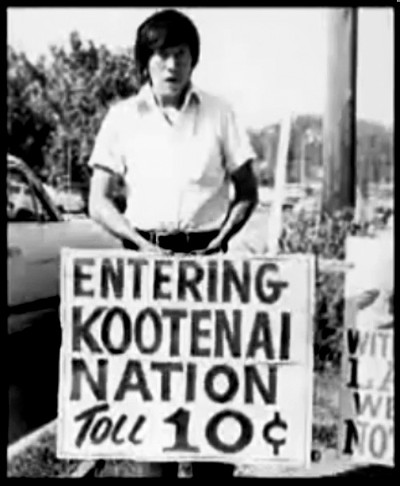 The Kootenai declared war in September 1974. They said the government had taken their land and set up stops to charge drivers a toll in Bonners Ferry, on their former land. This is Jimmy Shottenana, Kootenai, with one of those toll signs in 1974. (Courtesy Sonya Rosario/Missoula Independent.)