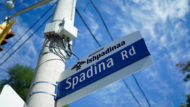 Official signs are cropping up across the city, with four of Toronto's major streets now bearing signs with their Anishinaabe names. Spadina, or Ishpadinaa, is one of them. (Craig Chivers/CBC) .