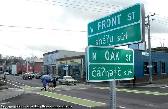 Keith Thorpe/Peninsula Daily News Street signs near Waterfront Park in Port Angeles, Washington, at the intersection of Front and Oak streets are now provided in both English and the local Klallam language. Similar signs appear at the intersection of Oak.