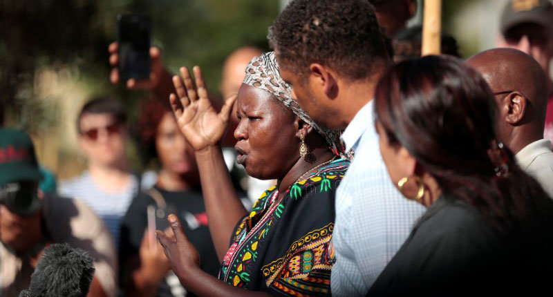 Agnes Hasam, a family friend of the Alfred Olango, speaks to protesters gathered at the El Cajon Police Department headquarters to protest fatal shooting of an unarmed black man Tuesday by officers in El Cajon, California, U.S. September 28, 2016. REUTERS/Earnie Grafton