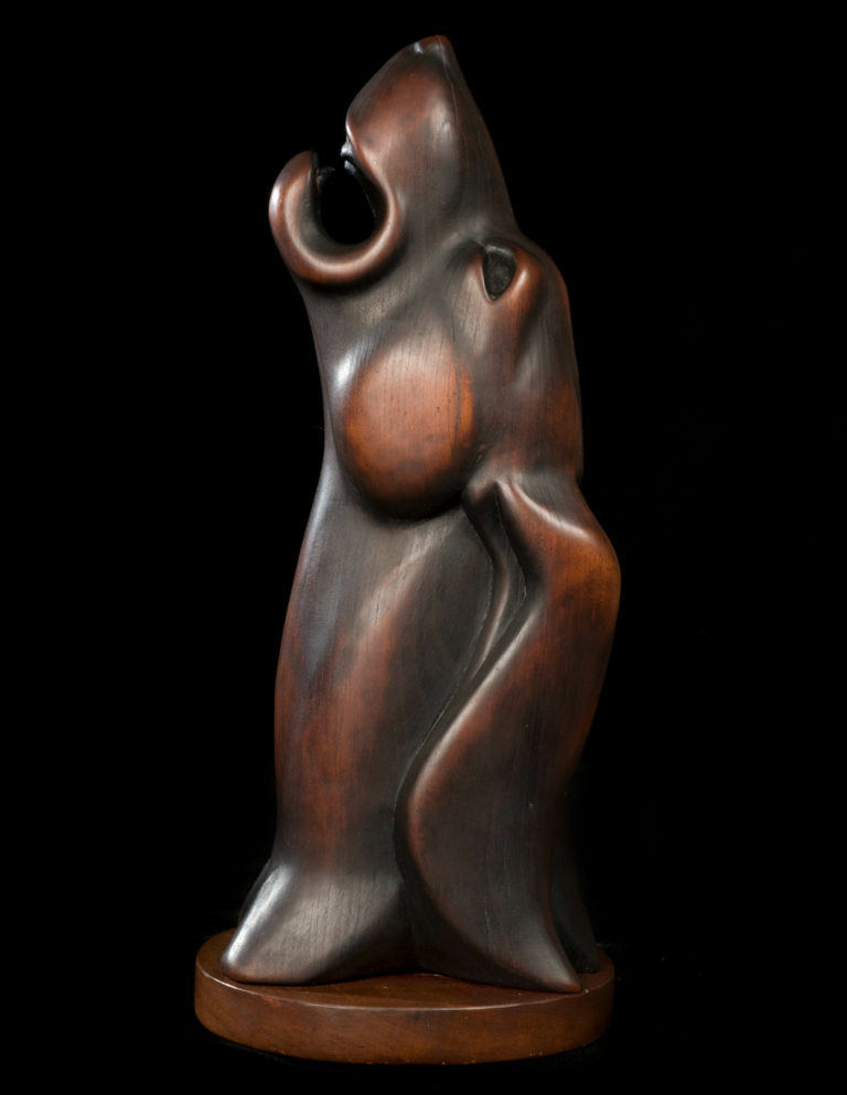 "Willard Stone, ""Tree Dog"" (nd), torch-burned cherry wood, 13 3/4 x 3 3/4 x 5 1/8 inches (courtesy Gilcrease Museum)."