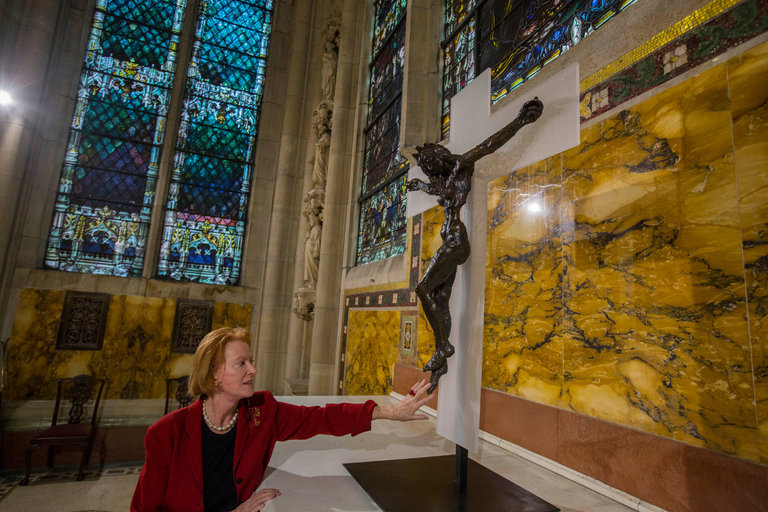 "The artist Edwina Sandys with her sculpture ""Christa,"" the centerpiece of an exhibition of more than 50 contemporary works that interpret the symbolism associated with the image of Jesus. Credit Hiroko Masuike/The New York Times."