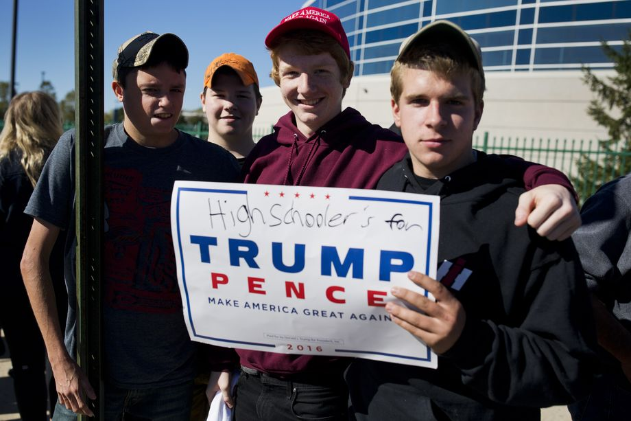 A group of high-school boys pose for a picture with a campaign sign for Republican presidential nominee Donald Trump outside the Mohegan Sun Arena before a rally, October 10, 2016, in Wilkes Barre, Pennsylvania. Dominick Reuter/AFP/Getty Images.