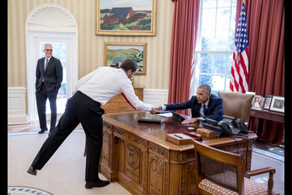 President Barack Obama congratulates Senior Advisor Brian Deese on the first day of the implementation of the Paris Agreement on climate change, in the Oval Office, Oct. 5, 2016. Deese worked with Secretary of State John Kerry and EPA Administrator Gina McCarthy to make the agreement possible. Chief of Staff Denis McDonough watches at left. Pete Souza/White House.