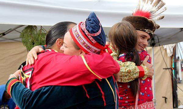Frank Cooper and Kaya Littleturtle of the Lumbee Tribe of North Carolina greet Sami representatives from Norway, Inger Biret, Kvernmo Gaup, and Sara Marielle Gaup Beaska on Friday. Desiree Kane.