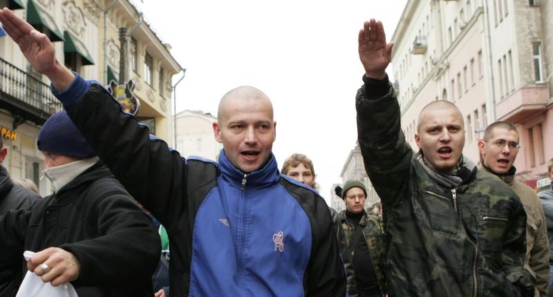 Skinheads enact Nazi salutes (Shutterstock).