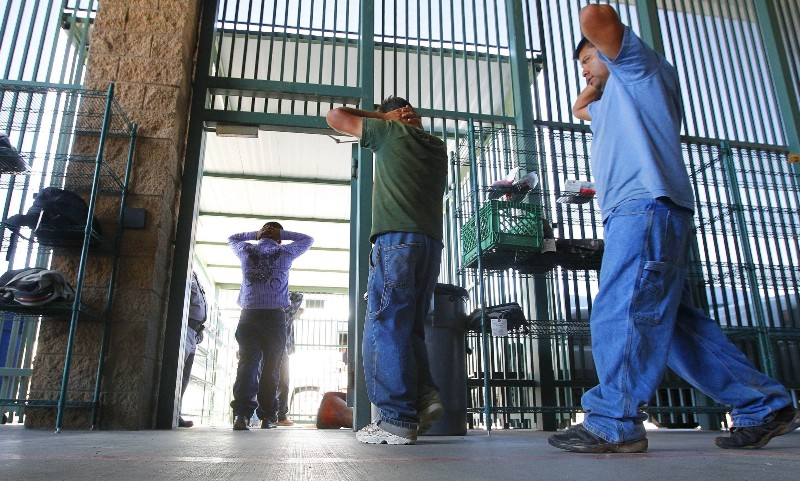 Suspected undocumented immigrants are transferred out of the holding area after being processed at the Tucson Sector of the U.S. Customs and Border Protection headquarters CREDIT: AP Photo/Ross D. Franklin, File.