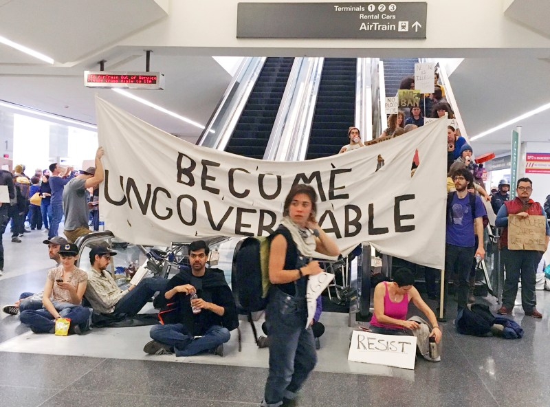 Demonstrators block an escalator at the international terminal as protests against President Donald Trump's executive order banning travel from seven Muslim-majority countries continue at San Francisco International Airport, Sunday, Jan. 29, 2017. (AP Photo/Olga Rodriguez).
