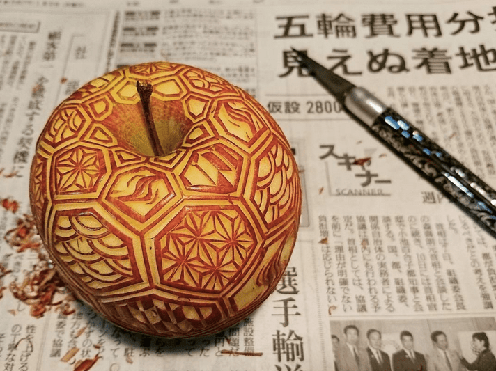 an apple, also carved with a variety of Japanese patterns (wagara).