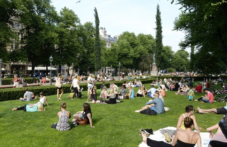 Esplanade Park in Helsinki. Finland, is the happiest country in the world, according to the newest World Happiness Report. Credit Martti Kainulainen/Lehtikuva, via Associated Press