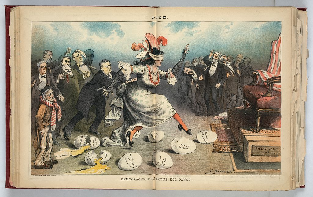 """Democracy's Disastrous Egg-dance, (1884), Joseph Keppler. A woman labeled """"Democracy"""" wearing a blindfold labeled """"Stupidity"""" is pushed by Samuel J. Randall toward a chair labeled """"Presidenti[al] Chair"""", with several eggs in the way on the ground, they are labeled """"Honest Naval Appropriation, Civil Service Reform, Honest River – Harbor Appropriation, Economy, Anti-Silver Coinage, National Banking System, Tariff Reform, [and] Prompt Legislation"""", two of the eggs are broken; among a group of men laughing, in the background on the right, are John Logan, John Sherman, and William D. Kelley. — Source."""