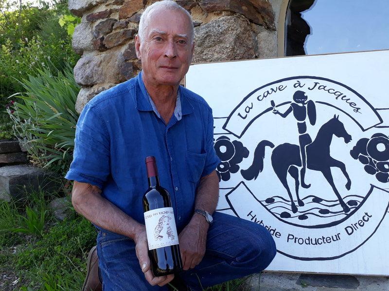Hervé Garnier poses with a bottle of wine from Beaumont. Courtesy of Hervé Garnier.