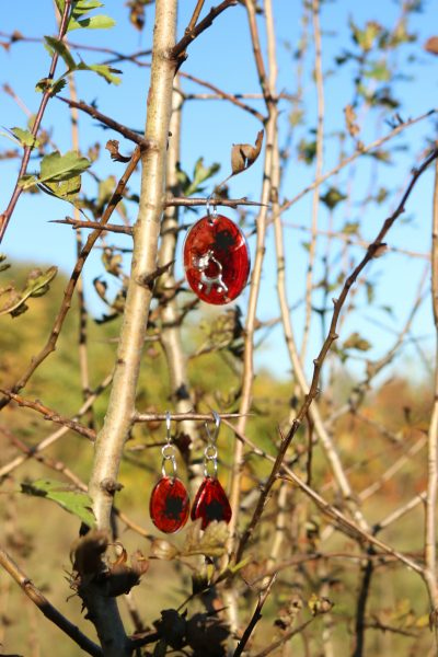Earrings and pendant in a thorny bush