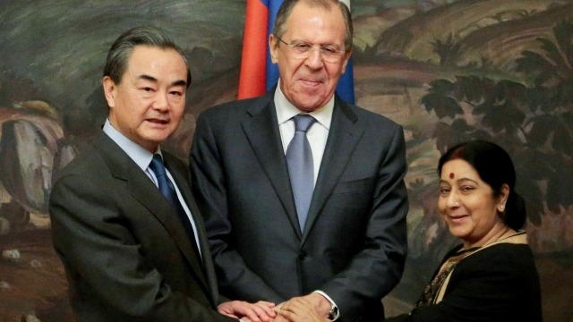 Chinese Foreign Minister Wang Yi, Russian Foreign Minister Sergei Lavrov and Indian Foreign Minister Sushma Swaraj pose before their meeting in Moscow, Russia, (PTI)