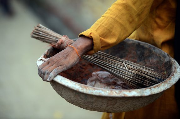 In this picture taken on August 10, 2012, shows a manual scavenger carrying tools of her profession, a basket, a broom and plastic shovel, while on her way to clean dry toilets in Nekpur village, Muradnagar in Uttar pradesh AFP/Getty