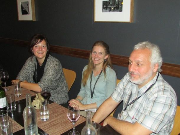 Jennifer Pentz, Dinah Davison, and Cristian Solari enjoying a glass of wine.