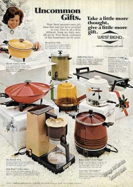 """1970s West Bend brand appliances ad depicting a smiling white woman dressed in a white lacy, ruffled blouse with a cameo brooch at the collar in the midst of opening gift boxes containing small kitchen appliances. Boldest text reads """"Uncommom Gifts."""""""