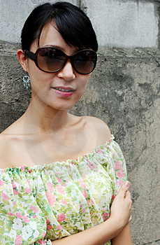 Stock Image - Asian woman wearing big shades
