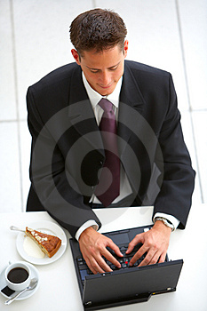 Stock Photo - Businessman at an airport restaurent (overhead view)