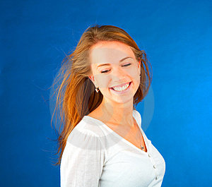 Stock Images - Smiling casual girl on blue background
